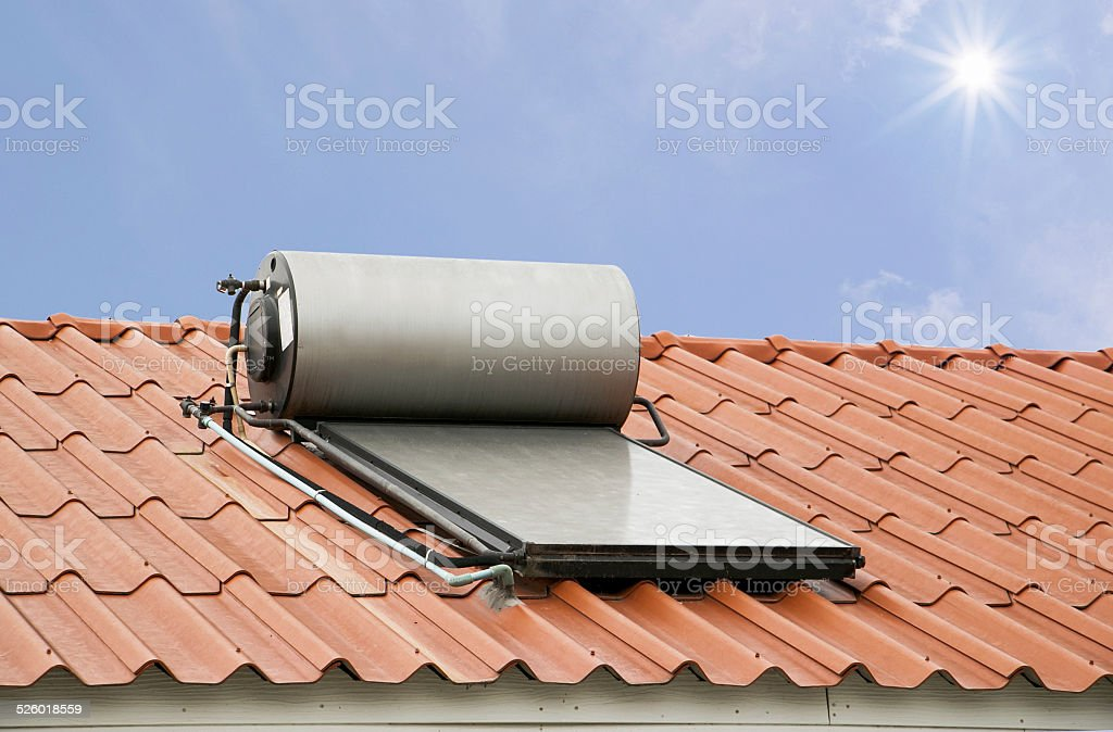 Solar panel for hot water system on roof under sunshine stock photo