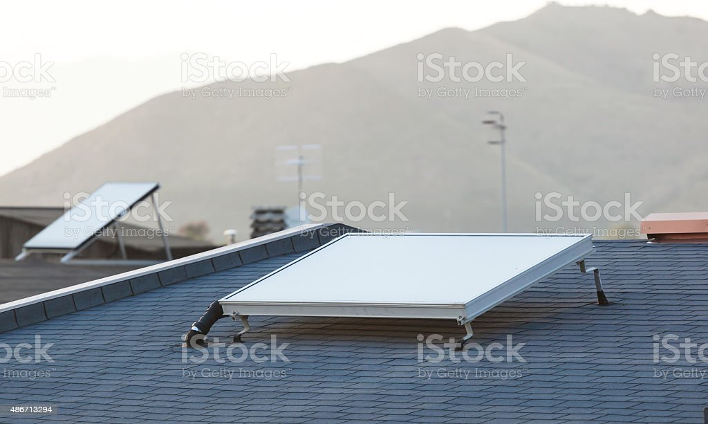 Solar panel for water heating system stock photo