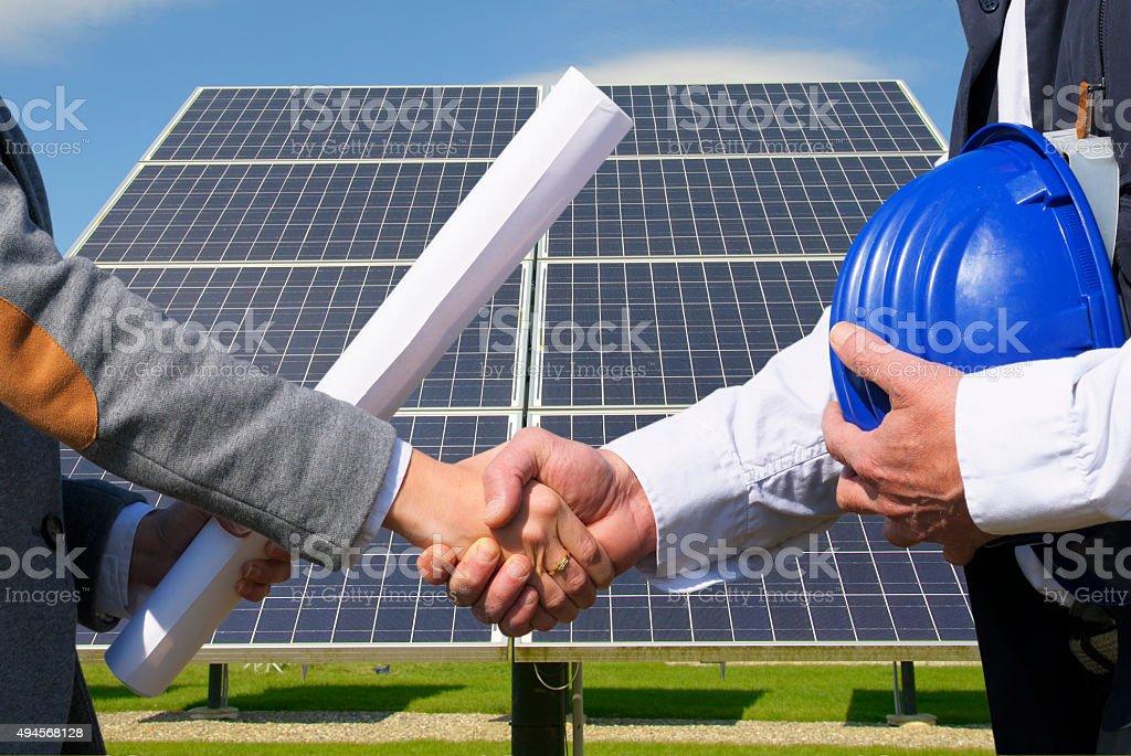 Solar panel handshake stock photo