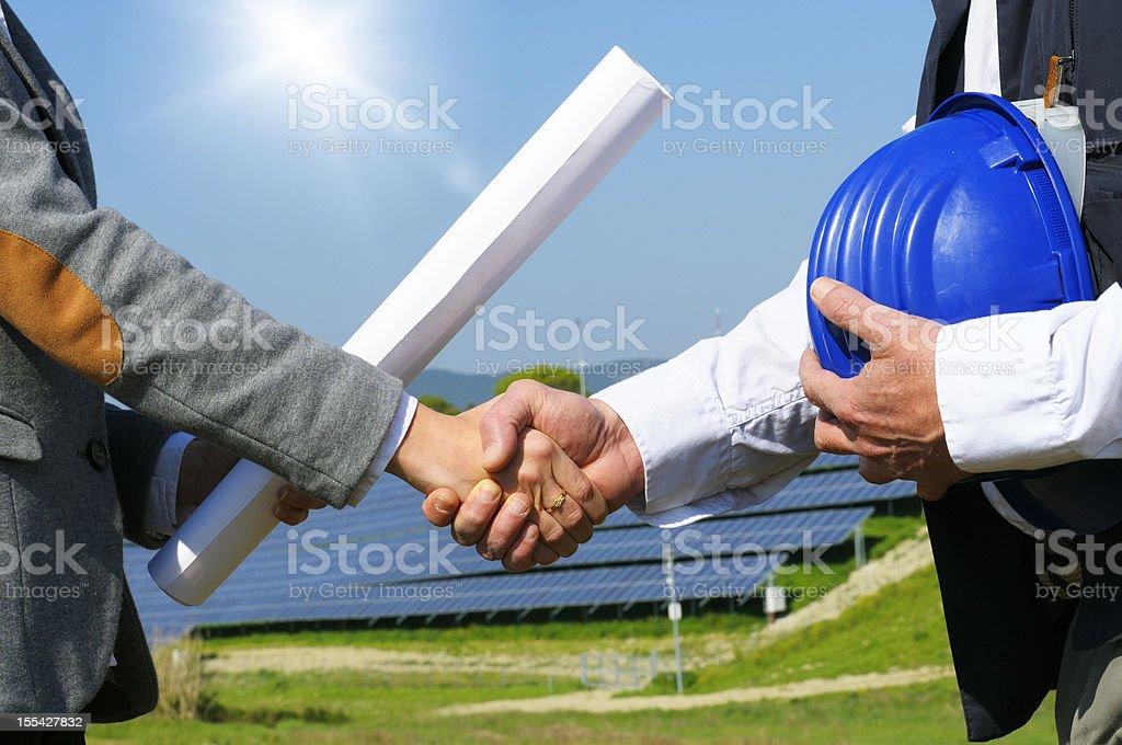 Solar Panel Handshaking stock photo