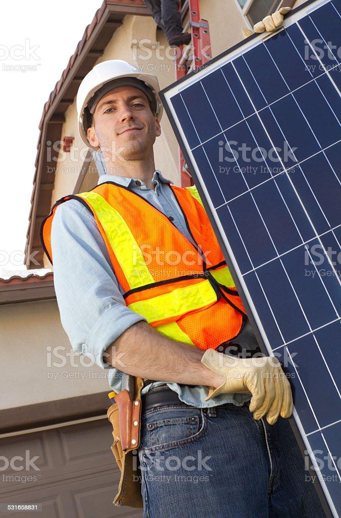 Solar Panel Man Orange Vest Angle Up stock photo