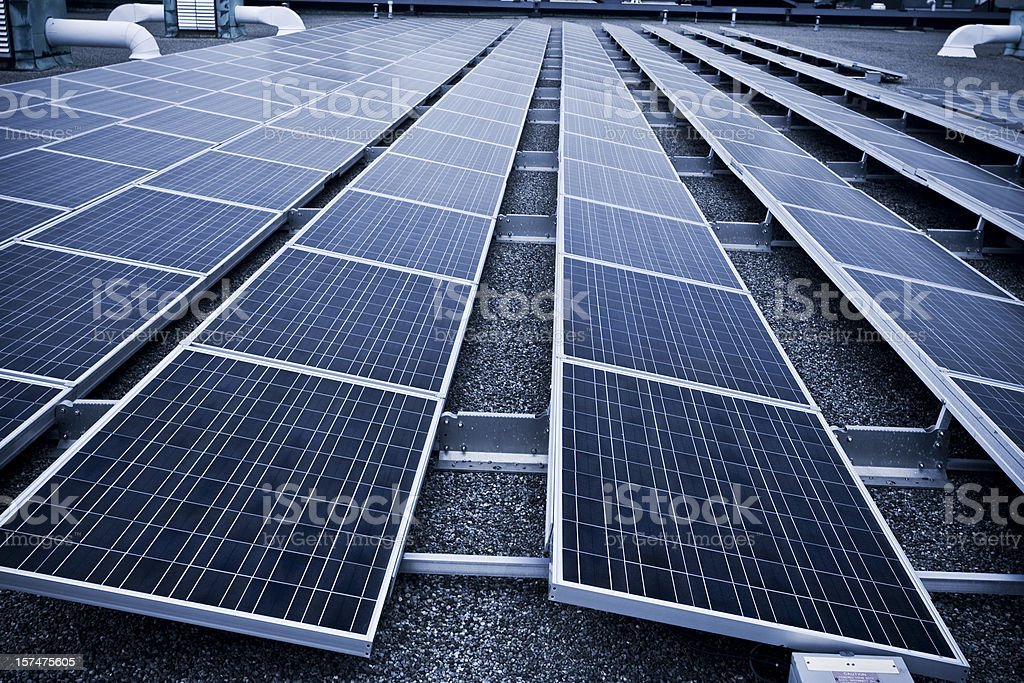 Solar panel on an industrial rooftop stock photo