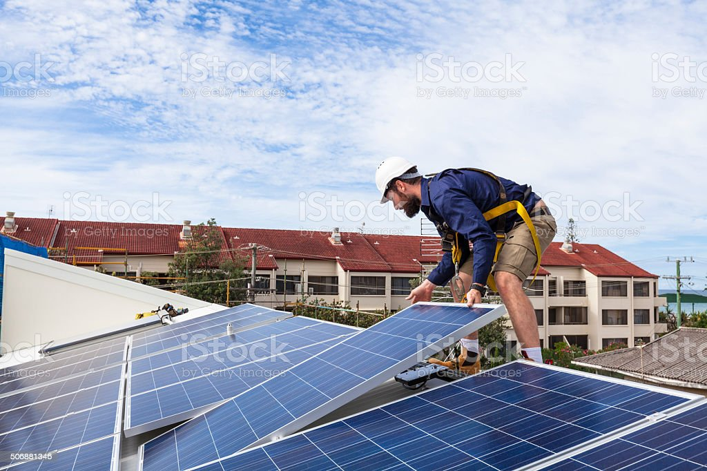 Solar panel technician stock photo