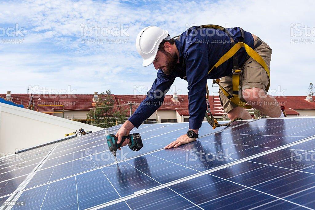 Solar panel technician stock photo