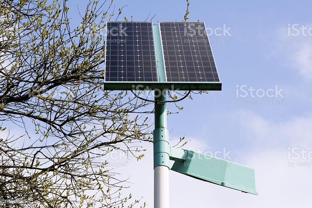 Solar panel with a street lamp royalty-free stock photo