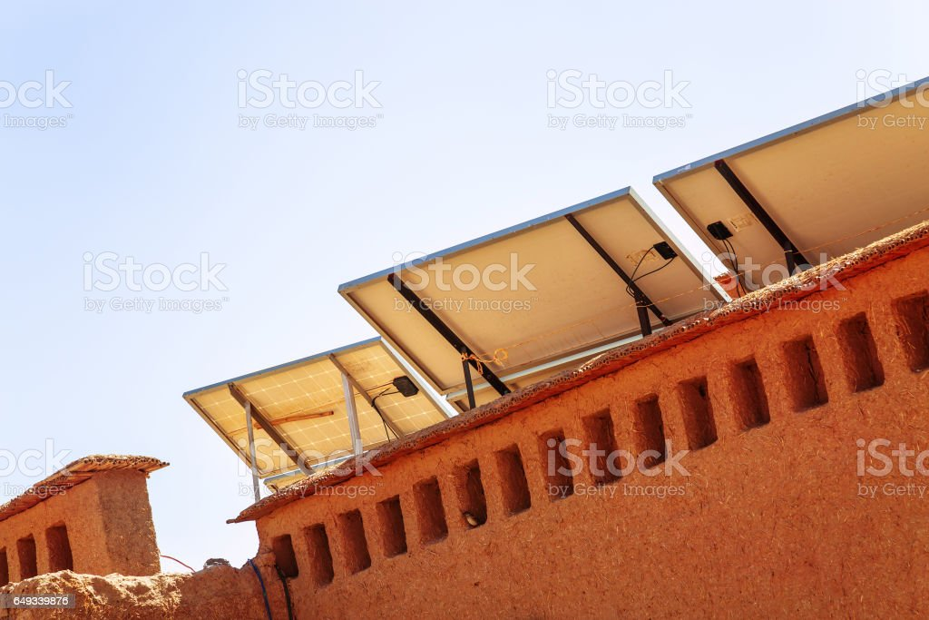 solar panel with desert house stock photo