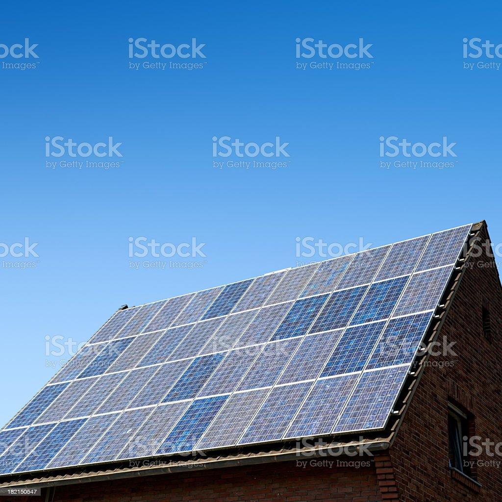 Solar panels against a blue sky with many copyspace royalty-free stock photo