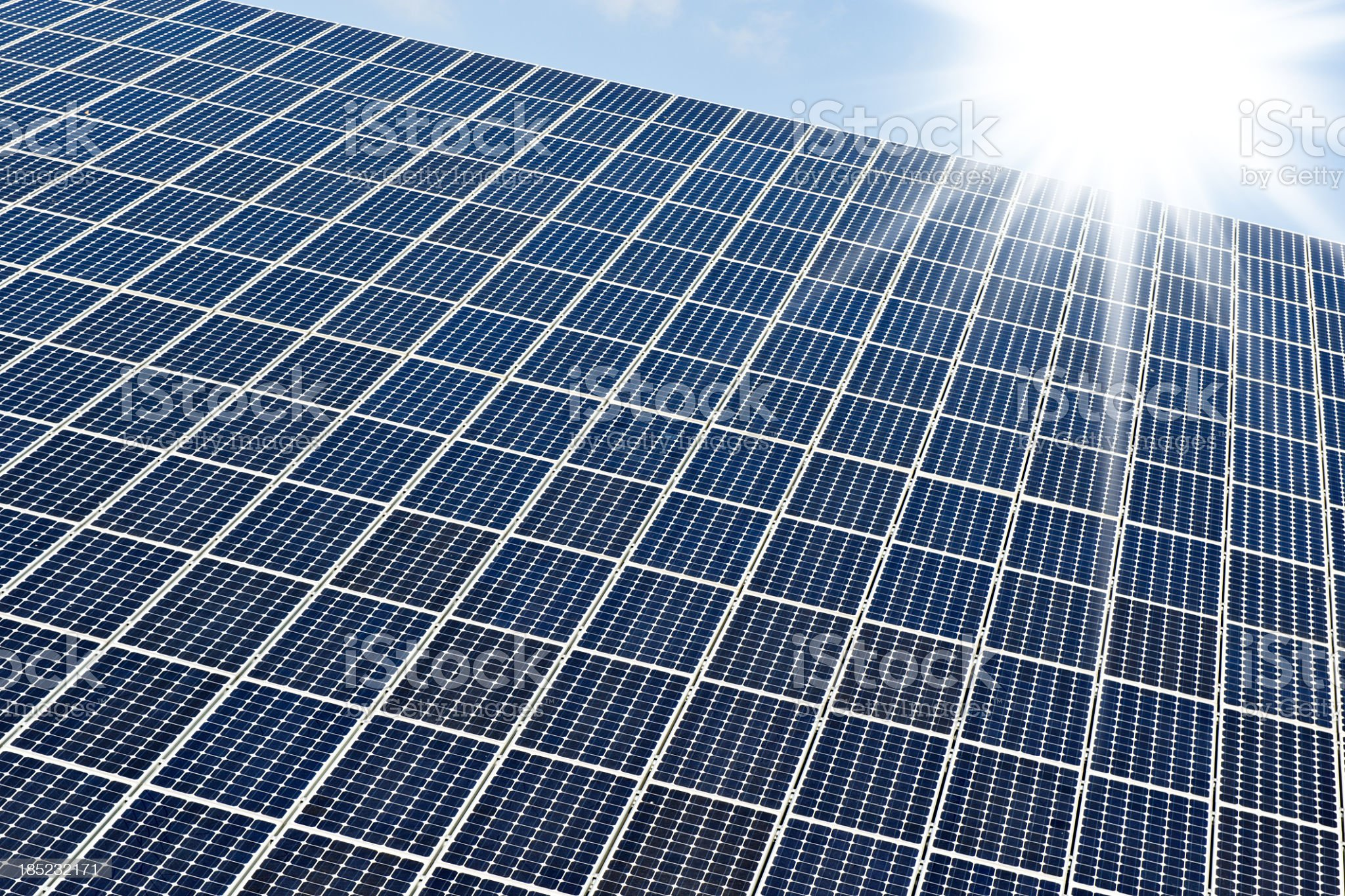 Solar panels against a sunny sky with many copyspace royalty-free stock photo