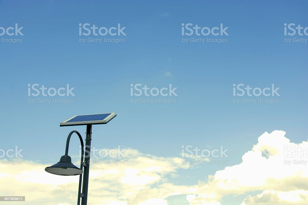 Solar panels and lamp with blue sky royalty-free stock photo