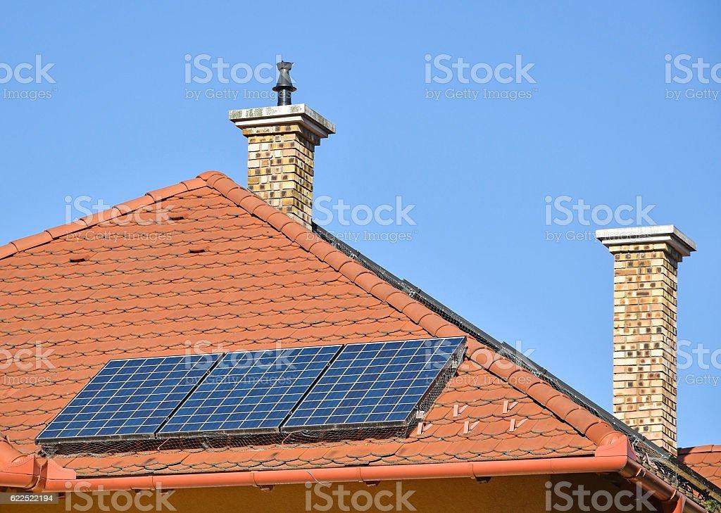 Solar panels and smoke stacks stock photo