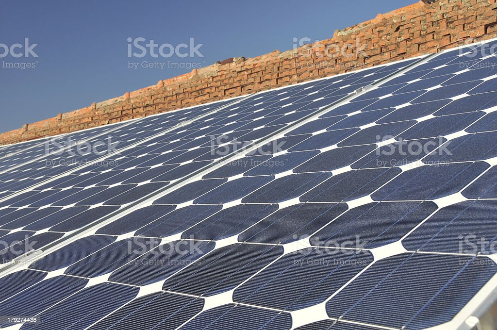 Solar panels and sun-baked tiles royalty-free stock photo