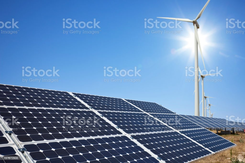 Solar panels and wind farm stock photo