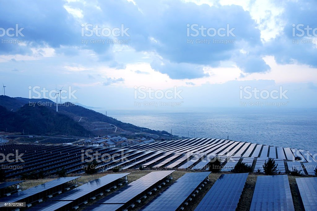 Solar panels and wind generators in Large Photovoltaic power station stock photo