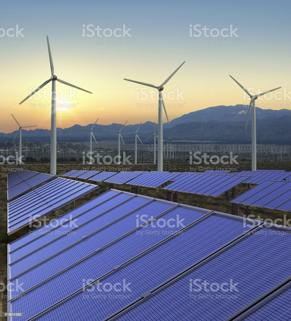 Solar panels and wind mills in renewable energy farm stock photo