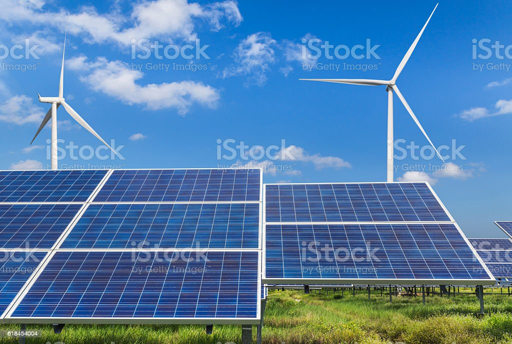solar panels and wind turbines alternative energy from nature stock photo