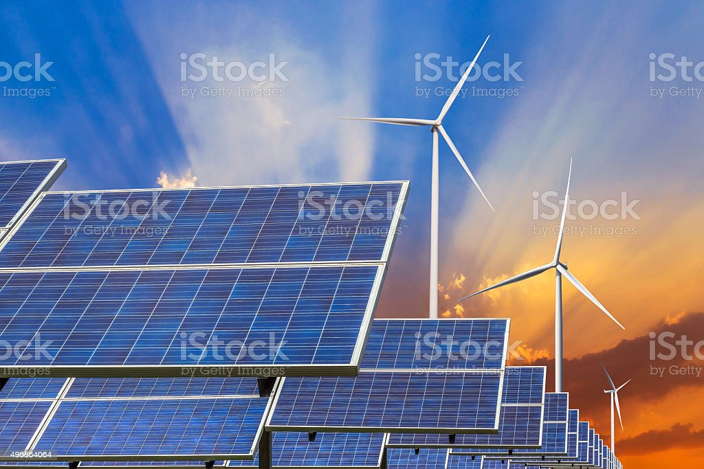 solar panels and wind turbines energy from natural stock photo