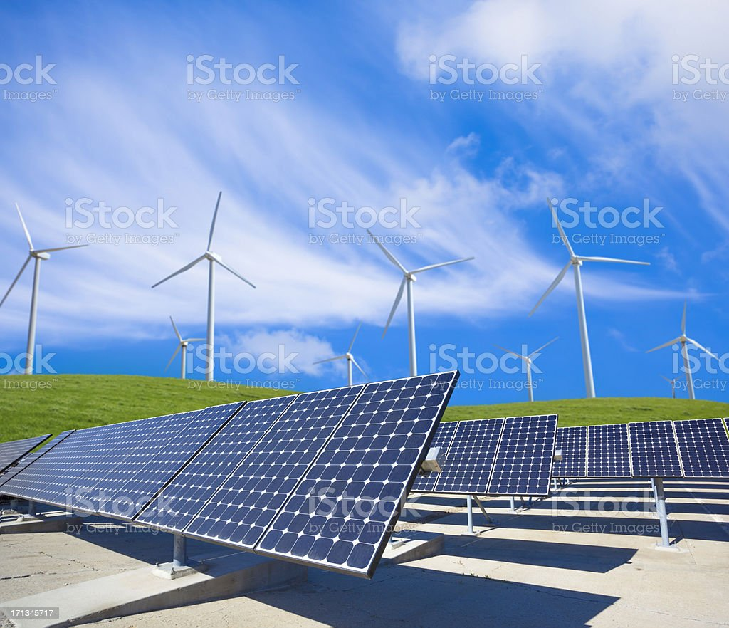 Solar Panels And Wind Turbines In A Green Field stock photo