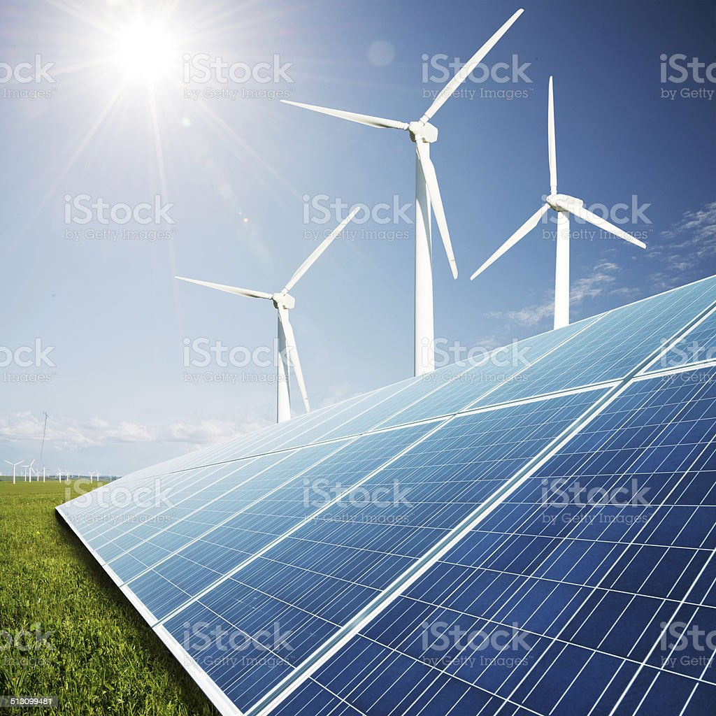 solar panels and windmill power plant stock photo
