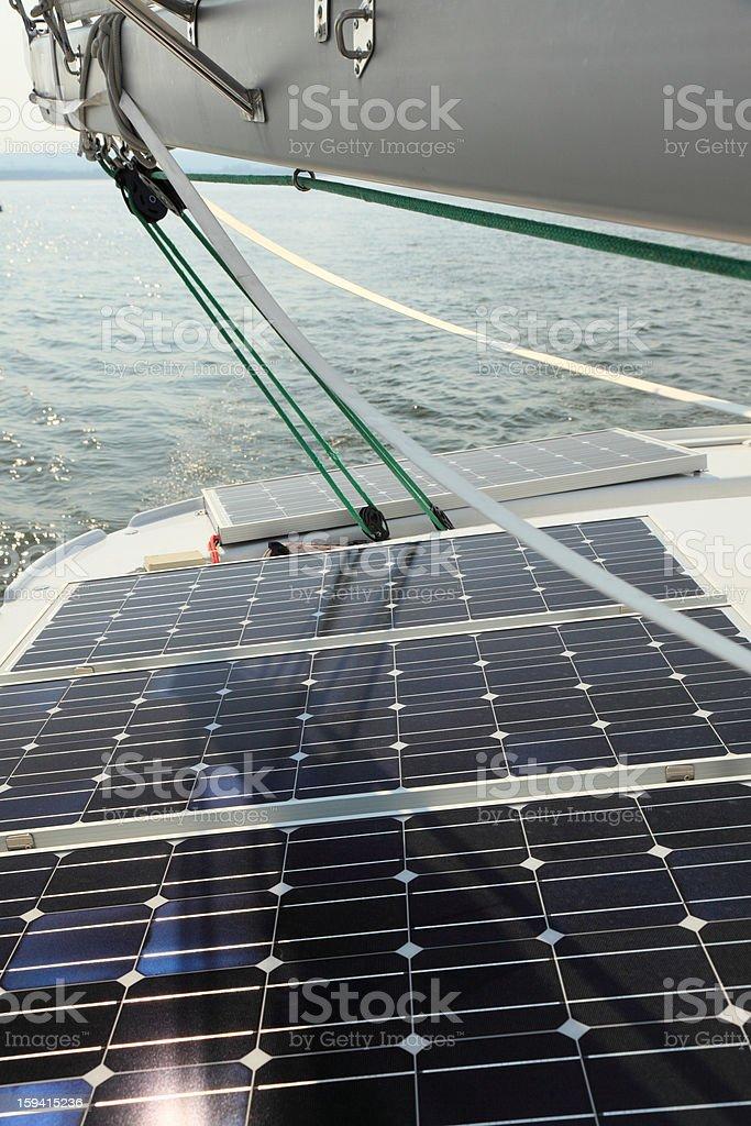Solar Panels charging batteries aboard sail boat royalty-free stock photo