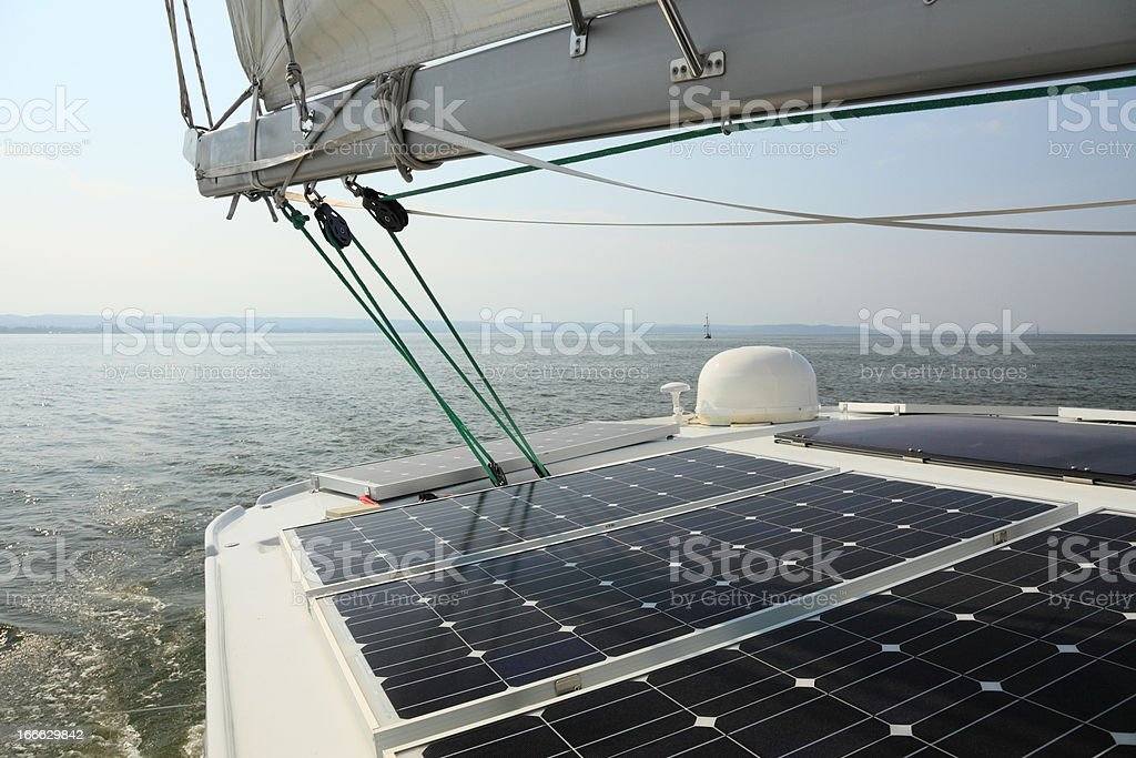 Solar Panels charging batteries aboard sail boat royalty-free stock photo