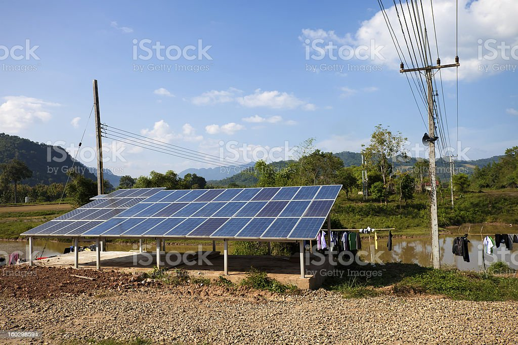 Solar panels in a backyard in rural Laos stock photo