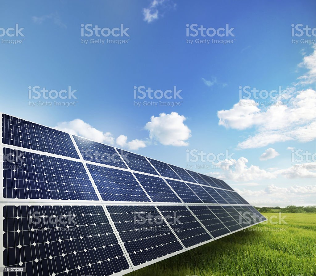 Solar Panels in a field of Grass. stock photo