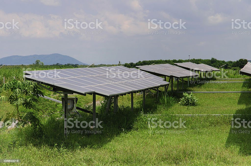 Solar panels in a green field royalty-free stock photo