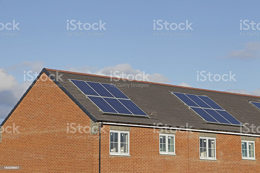 solar panels in a row of new uk houses royalty-free stock photo