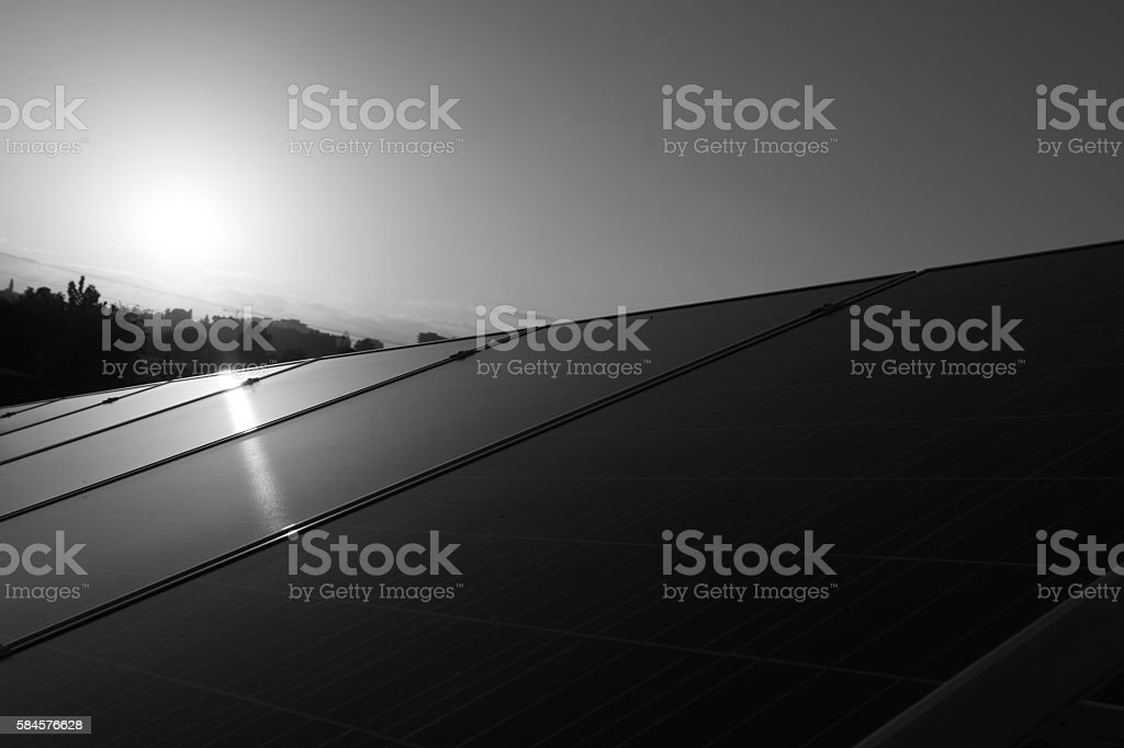 Solar panels in black and white stock photo