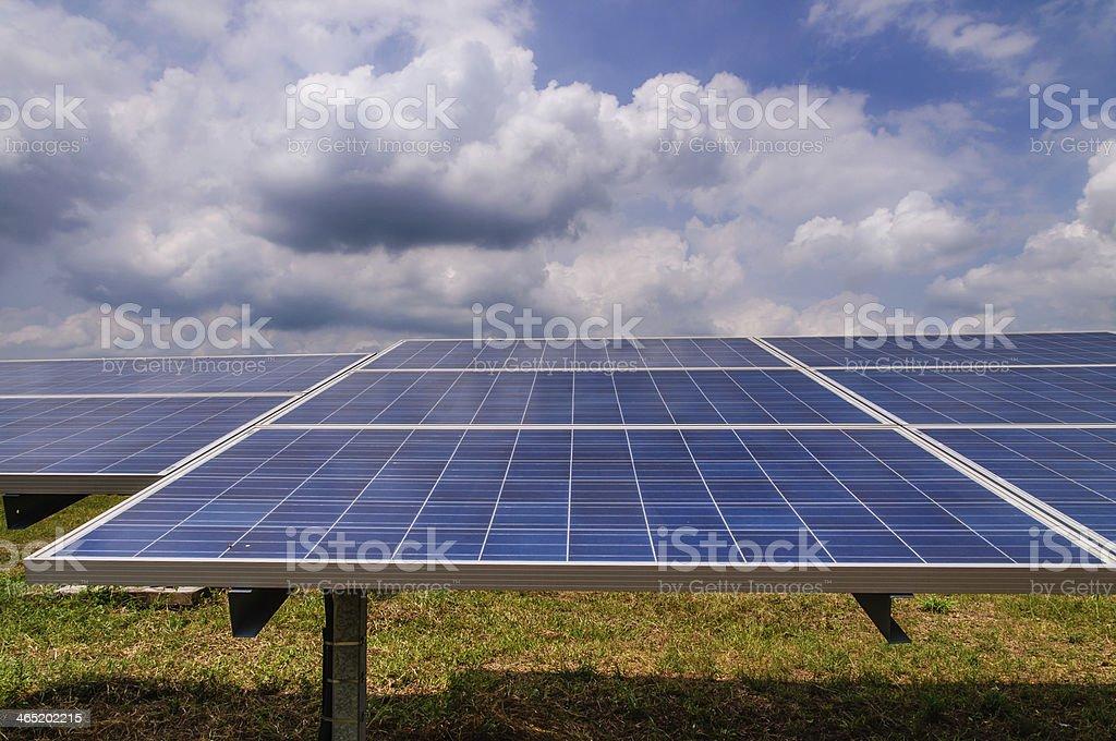 Solar panels in green field royalty-free stock photo