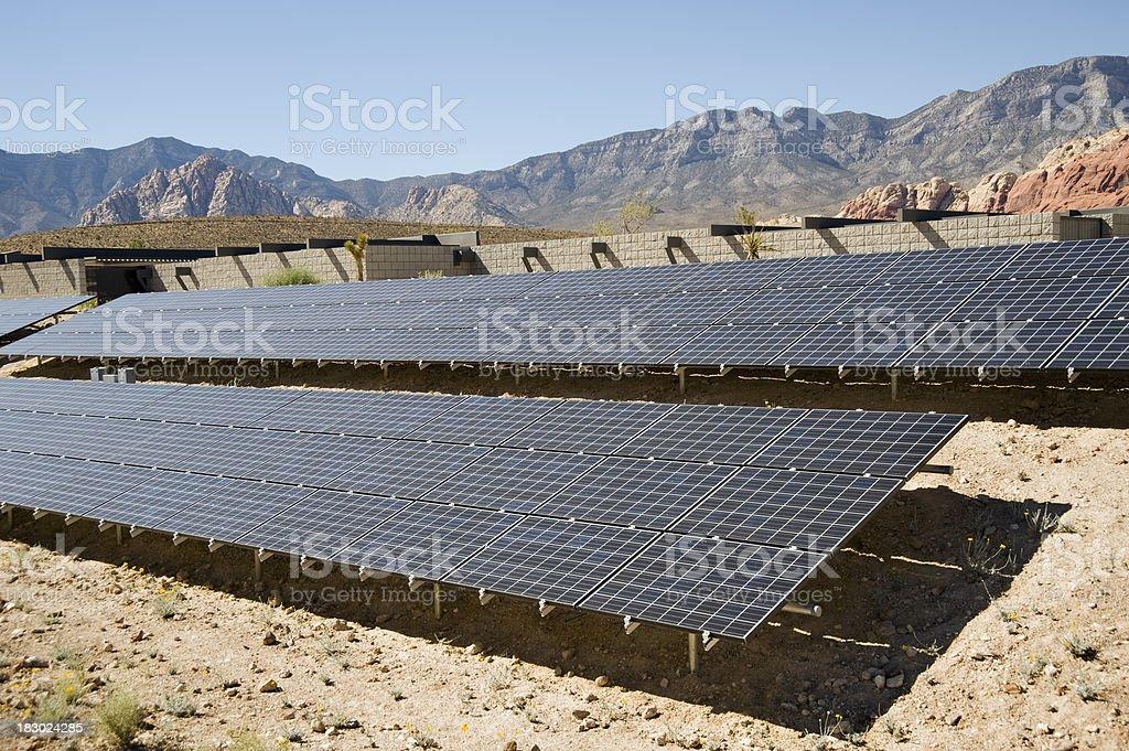 solar panels in the desert stock photo