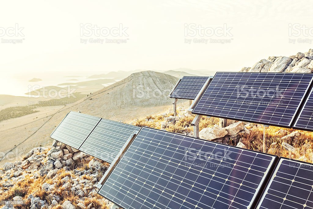 solar panels in the rocky desert stock photo