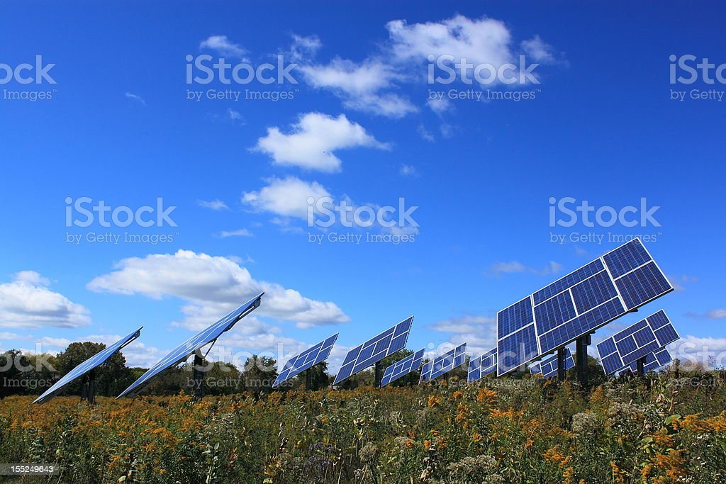 Solar panels installed in field stock photo