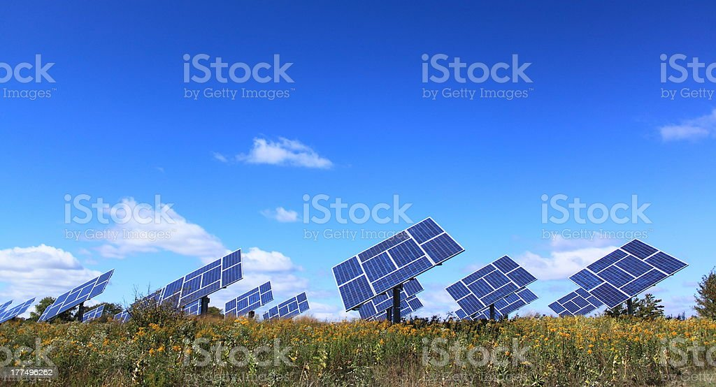 Solar panels installed in field royalty-free stock photo
