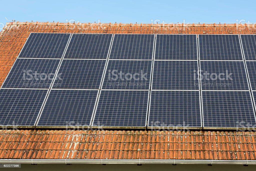 Solar panels on a brick roof stock photo