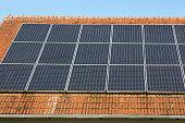 Solar panels on a brick roof