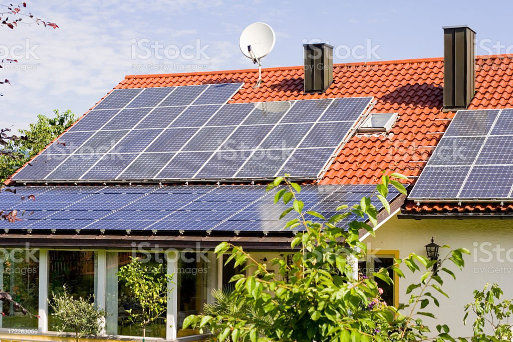 Solar panels on a house rooftop stock photo