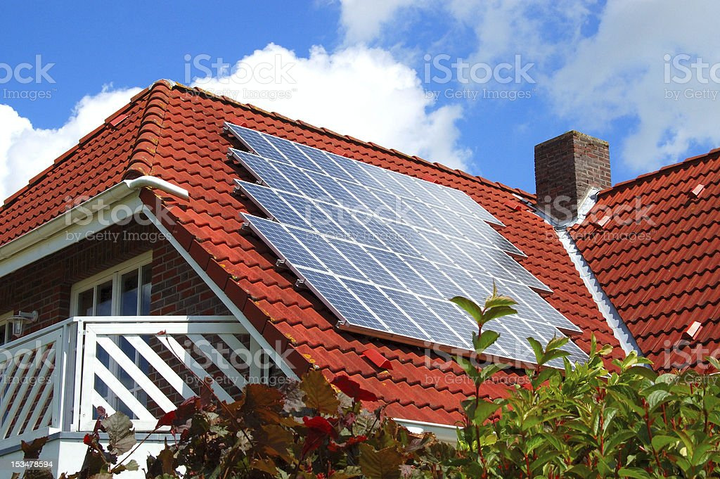Solar panels on a red roof of house royalty-free stock photo