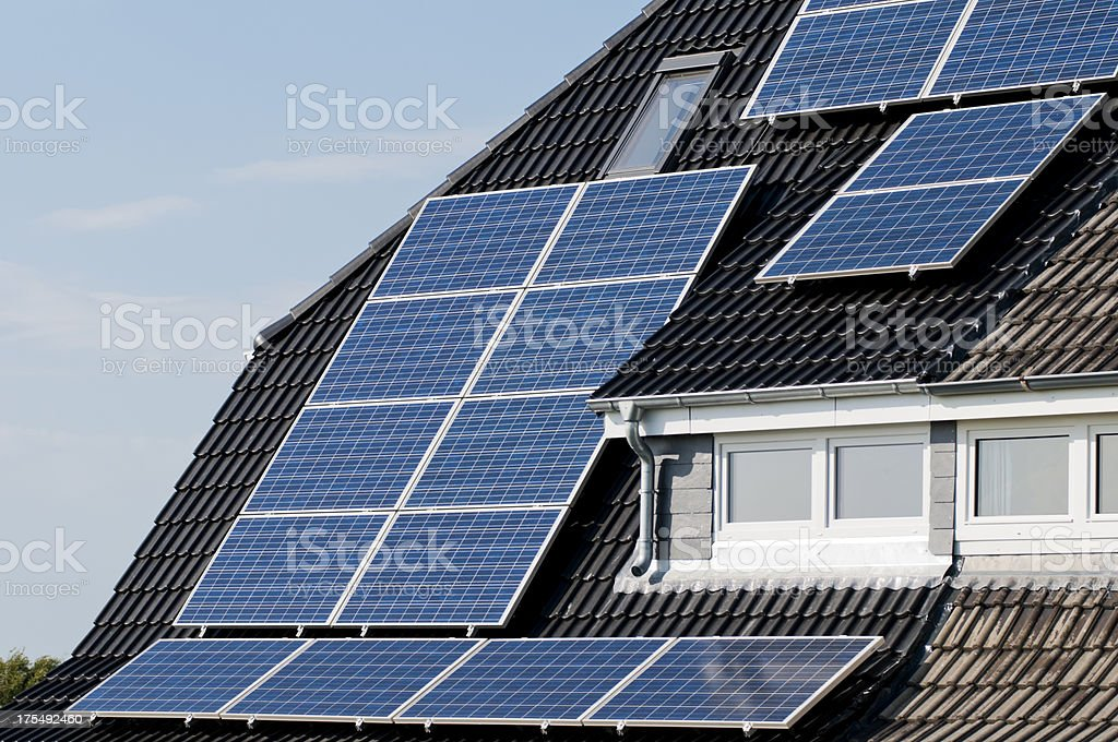 Solar panels on a roof stock photo
