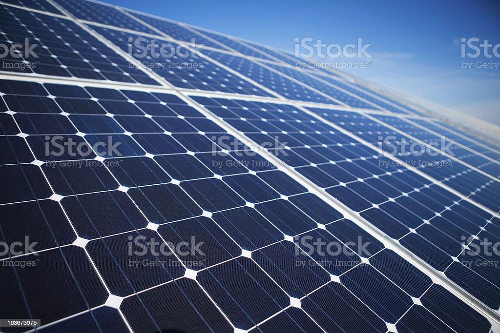 Solar panels on a sunny day against clear blue sky stock photo