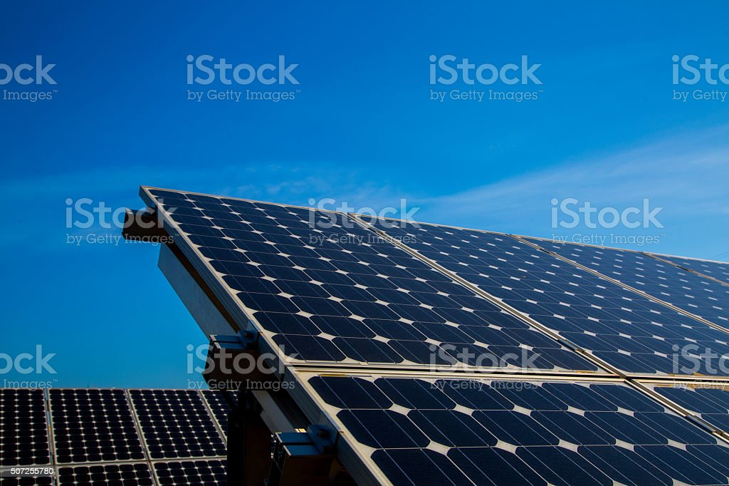 Solar panels on a sunny day against clear blue sky stock photo
