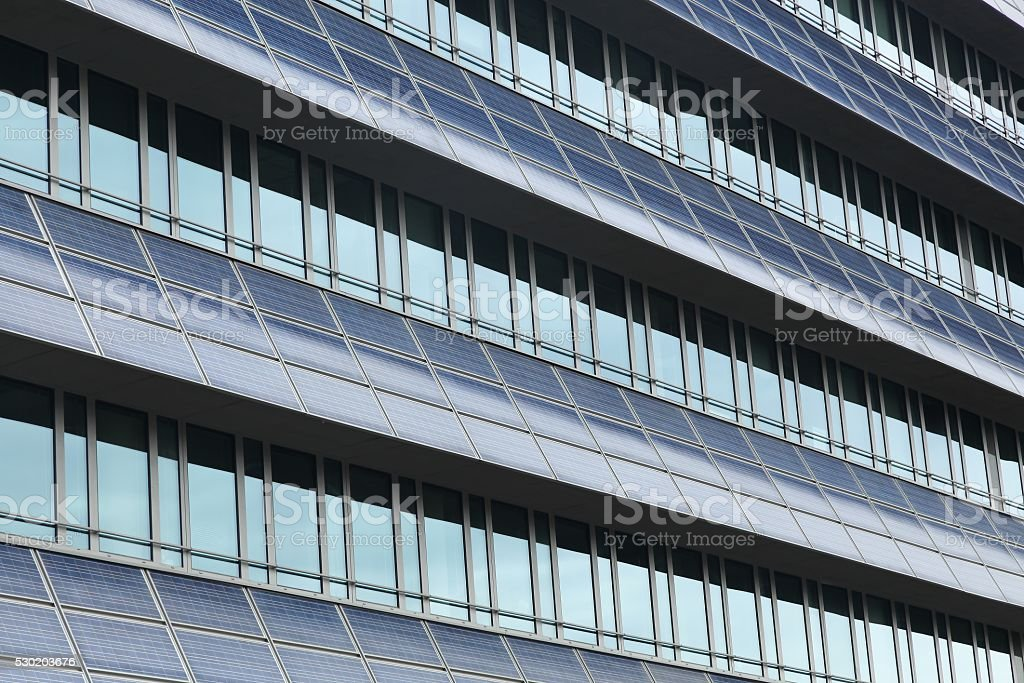 Solar panels on a wall of a building stock photo