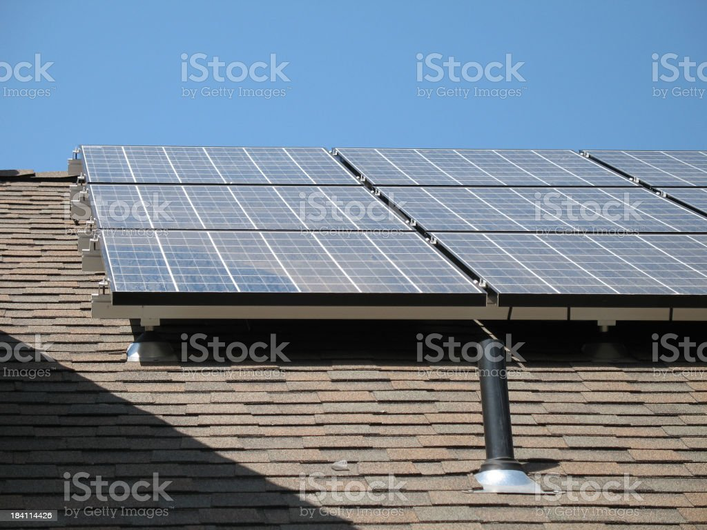 Solar Panels On Asphalt Roofing royalty-free stock photo