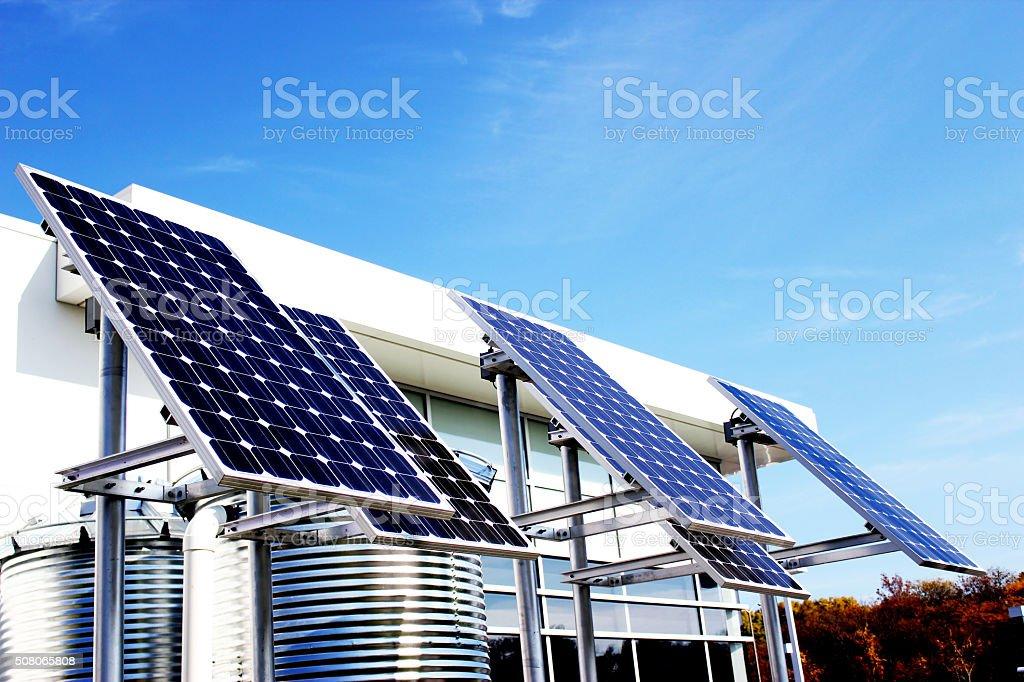 Solar panels on blue sky background stock photo
