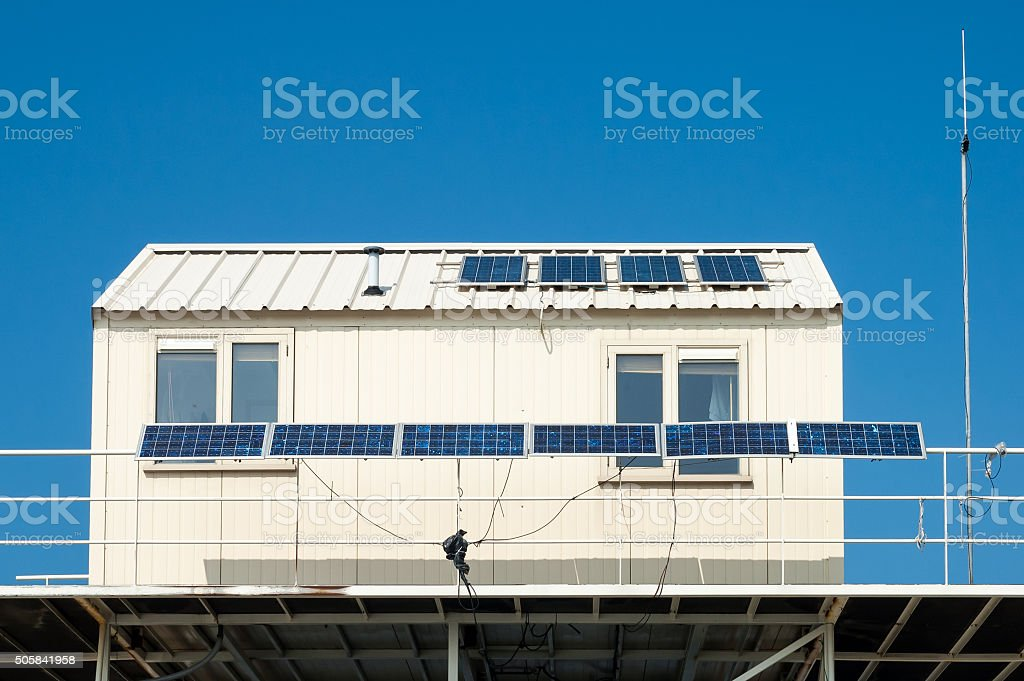 Solar panels on roof of cabin stock photo