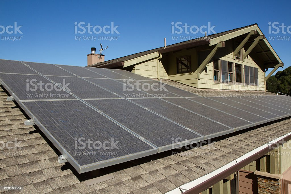 solar panels on roof of house stock photo