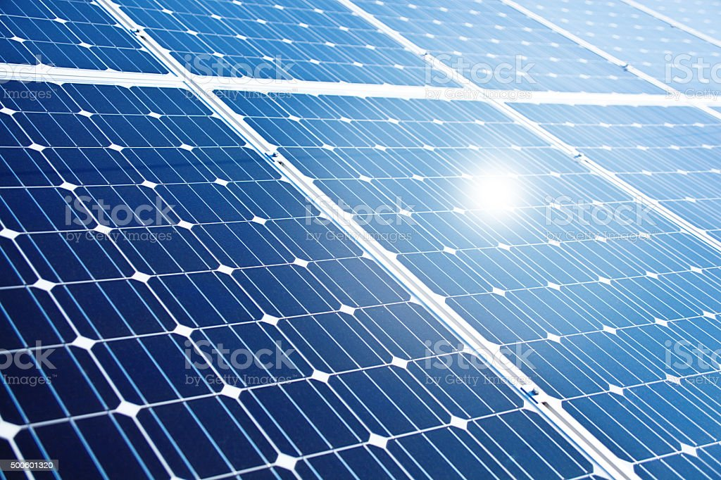 Solar Panels on Roof Top of Residential Home Garage stock photo