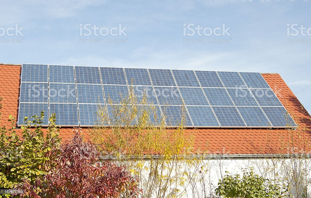 solar panels on roof with blue sky stock photo