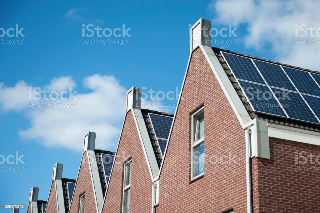 Solar panels on roofs stock photo