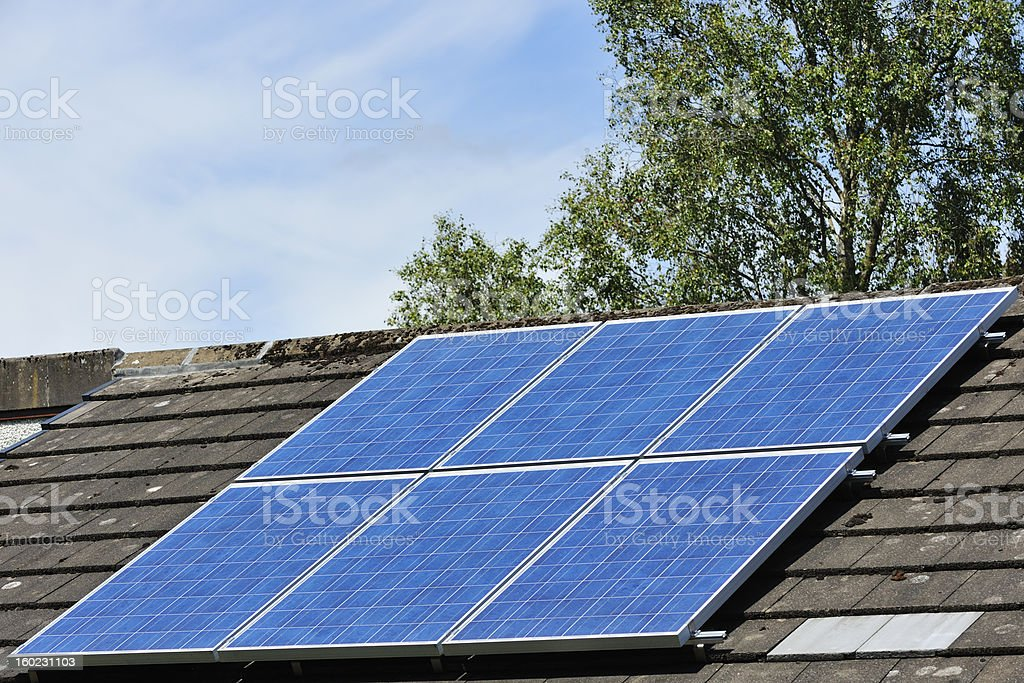 Solar panels on the roof of a building stock photo
